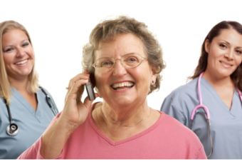 Elderly woman patient on the phone with 4 medical staff around